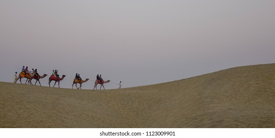 Riding camel on Thar Desert in Jaisalmer, India. Thar Desert is a large arid region in the northwestern part of the Indian.