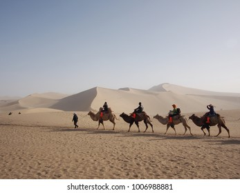 Riding a Camel in A Part of Silk Road in Dunhuang Desert. Travel in Dunhuang City, Gansu, China. in 2013, October 14th