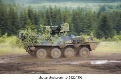 Riding combat vehicle from battle. Retreat from the enemy.