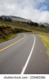 Riding down Haleakala highway in Haleakala National Park, Maui on a bike. Motion blur in foreground.