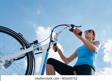 Riding electric bicycle or e-bike, shot against blue sky, convenient copy space