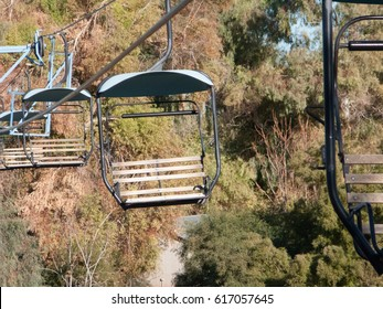 Riding high above tree line in open cabins