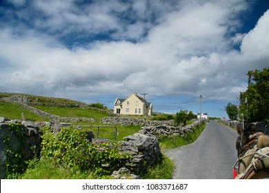Riding a horse and trap on Cottage Road from Kilronan village, Inishmore, Aran Islands, Country Galway, ireland