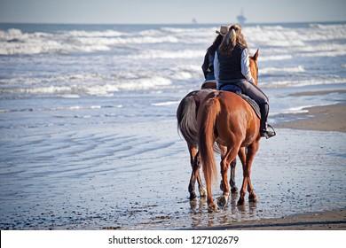 Riding Horses on the Beach
