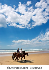 Riding Horses on the Beach
