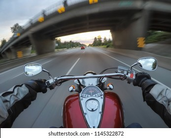 Riding a motorcycle during a vibrant sunset. Taken in Surrey, Greater Vancouver, British Columbia, Canada.