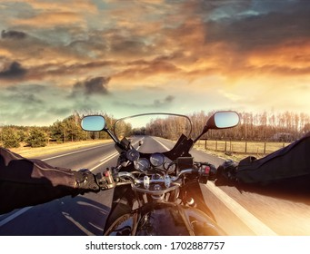 riding a motorcycle on the road on a sunny day