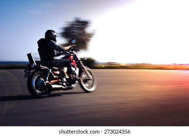 Riding motorcycle pan technic used.