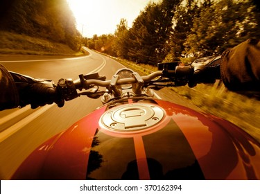 Riding motorcycle in the sunset.