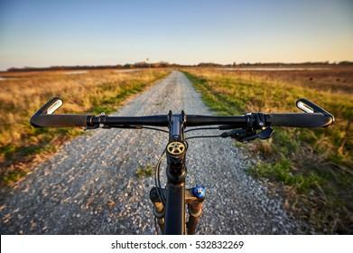 riding a mountain bike on a gravel trail