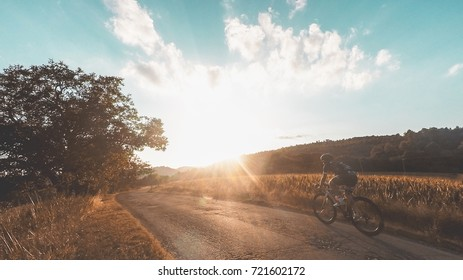 Riding on bicycle at sunset