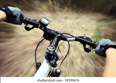 Riding on a bike on forest's path