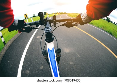 Riding on a bike , road and field
