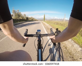Riding a racing bicycle in Tuscany during spring season. Personal perspective