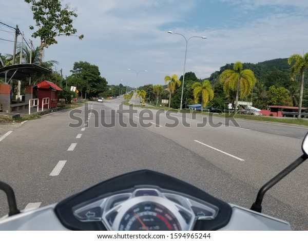 Riding the scooter somewhere on the amazing island Langkawi, Malaysia.