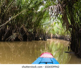 riding through the Mekong Delta in Vietnam in a sampan boat