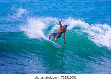 Riding the waves. Costa Rica, surfing paradise. Alberto Munoz, one of the top ten surfers in Costa Rica