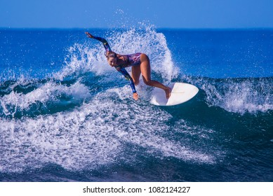 Riding the waves. Emily Gussoni, the great international surfer practicing at her favorite beach. Costa Rica, surfing paradise