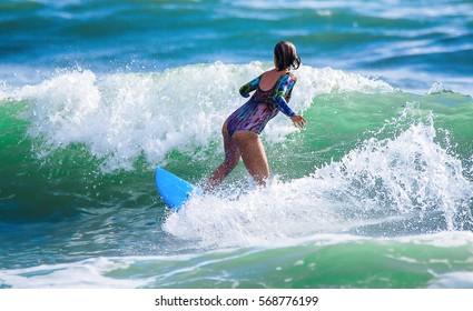 Riding the waves. Hermosa Beach, Costa Rica