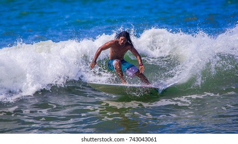 Riding the waves. Jose Pablo Cascante, an excellent Costa Rican surfer. Costa Rica, surfing paradise