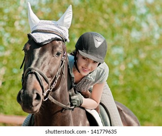 riding young woman on horse in outdoor
