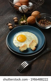ried egg with ingredients around - dark wooden table - closeup