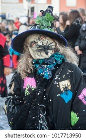 Riedisheim - France - 4 February 2018 - portrait of old woman masked witch and hat  parading in the street in the suburbs of Mulhouse