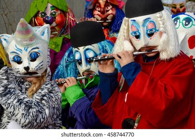 RIEHEN, SWITZERLAND - FEB 05: Carnival parade on February 5, 2016. A colorful parade of carnival masks in the city of Riehen revives a centuries old tradition of masked and costumed performances.