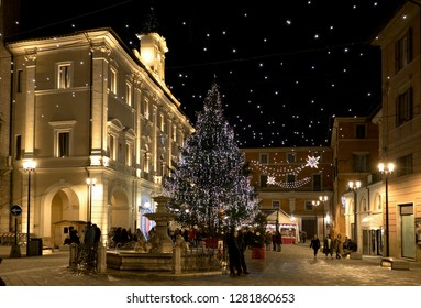 Rieti, Italy - 23 December 2018 - The historic center during the Christmas holidays with lights decorations. View of central square, Christmas tree and pepple walking