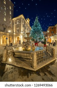 Rieti, Italy - 27 December 2018 - The historic center of the Sabina's provincial capital, during the Christmas holidays with lights decorations. Here the cental square and Christmas tree