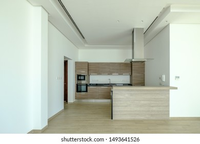 RIFFA, BAHRAIN - MARCH 02, 2019: Interior kitchen space of a modern villa in a Middle Eastern, high-end, luxury housing development on a sunny day with strong shadows.