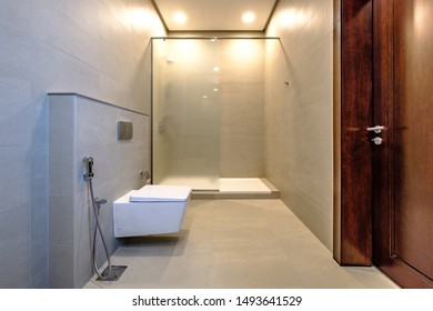 RIFFA, BAHRAIN - MARCH 02, 2019: Interior bathroom space of a modern villa in a Middle Eastern, high-end, luxury housing development on a sunny day with strong shadows.