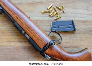 Rifle Bearing On Wood Background Stock Photo Edit Now 240522298