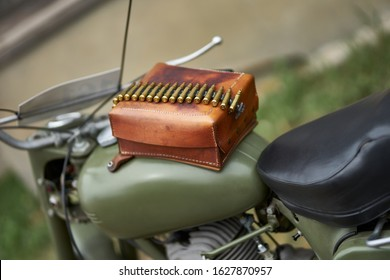 Rifle bullets at leather box