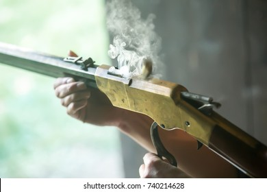 Rifle and cartridge, closeup landscape view, smoke, black powder