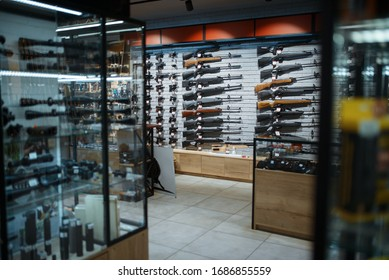 Rifle choice, showcase in gun shop, nobody