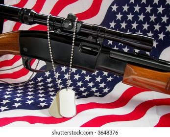 rifle, dog tags and flag