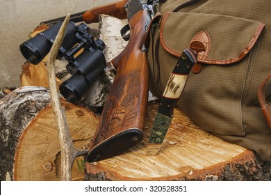 Rifle with hunting knife