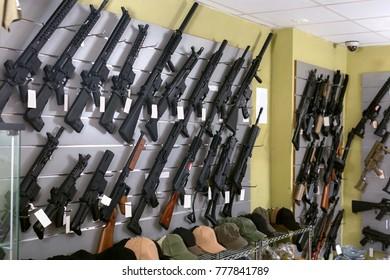 Rifle kalashnikov hangs on the wall in military shop closeup