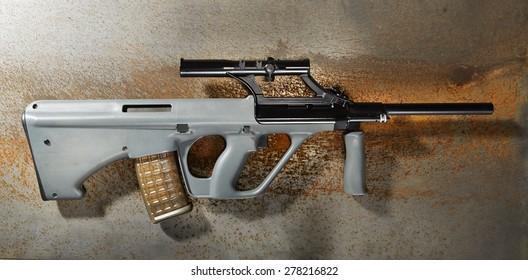 rifle on rusty background