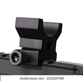Rifle sight base installed on an AR-15 rail with white behind