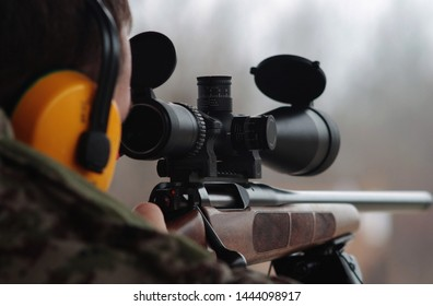 rifleman with sniper rifle looking in scope