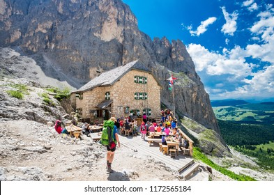 RIFUGIO VICENZA, SASSOLUNGO MASSIF, ITALY, JULY 1, 2018: Mountaineering people resting at Vicenza chalet in Dolomites mountains.