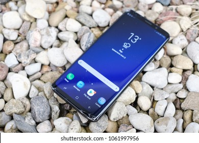 RIGA, APRIL 2018 - A smashed recently launched Samsung Galaxy S9 Plus smartphone with cracked screen is displayed for editorial purposes