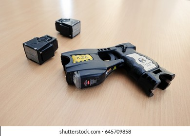 Riga, August 26, 2016 - A police issued Taser X26 stun gun and two cartridges are displayed on a table for inspection.