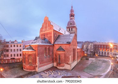 Riga Cathedral or Cathedral of Saint Mary at Cathedral Square during evening blue hour, Doma laukums, Riga, Latvia. Aerial panoramic view