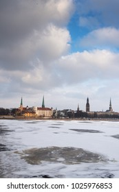 Riga city across Daugava river in winter time, Latvia.