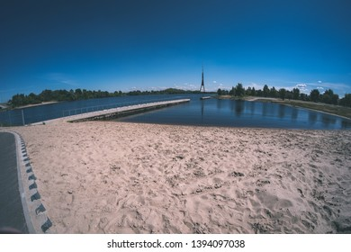 Riga city, capital of Latvia panoramic view with river Daugava and cable bridge with calm water in summer - vintage retro film look
