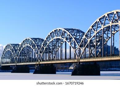 Riga city railway bridge against the blue sky