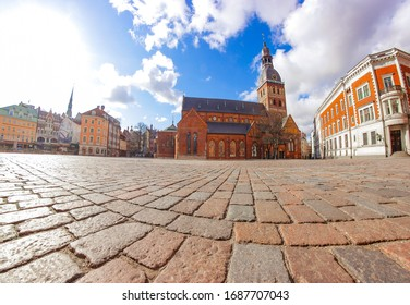 Riga Dome Cathedral - Rīgas Doms/Doma baznīca. Most famous landmark in Latvia. Impressive church and building in the heart of the Old Town on empty Dome Square during the fight against coronavirus.